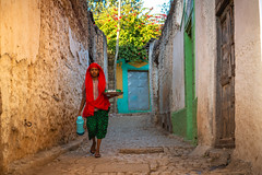 A woman carrying tea flask and tea cups, Harar, Ethiopia