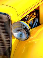 canary eye... (Stu Bo) Tags: sbimageworks showcar smooth sunlight headlight vivid vintageautomobile vintagecar hotrod oldschool onewickedride details dreamcar yellowcar streetrod sexonwheels