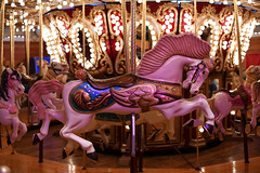 Catch A Painted Pony, Let The Spinningwheel Turn (Anthony Mark Images) Tags: carousel paintedponies pinkponies horses horseswithwings music lights lightbullbs childrens rides fun pretty beautiful lovely gorgeous wonderful seattle washington usa prettyponies pink nikon d850 art sundaylights