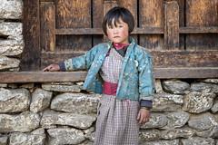 Serious little girl in the village of Lhedi - Lunana Gewog - Gasa District - Snowman Trek - Bhutan (PascalBo) Tags: nikon d500 asie asia southasia asiedusud drukyul drukgyalkhap bhutan bhoutan འབྲུག་ཡུལ། འབྲུག་རྒྱལ་ཁབ་ snowman trek trekking hike hiking lunana gasa himalaya himalayas jigmedorjinationalpark indigenous people girl fille child enfant kid portrait outdoor outdoors pascalboegli