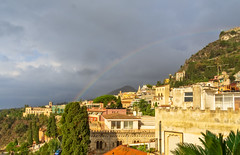 Mount Etna is somewhere there (Tigra K) Tags: taormina provinceofmessina italy it 2018 architecture church landscape mountain palace rainbow sicily town tree wall arch