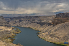 Snake River Canyon (TheArtOfPhotographyByLouisRuth) Tags: landscape water river sky mountain sea hills snakeriver swanfallsdam dam hydrodam rocks cliffs detail clouds rain storm idaho snakeriversize canyon nikon nikon85mmf18 autofocuslevel flickrsocial weather primelenses artofimages autofocuslevel2 autofocuslevel3 autofocuslevel4 autofocuslevel5 autofocuslevel6 cloudy amazing stormclouds rocky terrain evilkenevil epicshot epicphoto ambient mist mystical beautifulcapture dramaticskies sellyourart flickrglobal amazingcapture idahoparksandrec therebeastormbrewing cloudsstormssunsetssunrises autofocuslevel7 autofocuslevel8 crazyweather rainclouds rainyphotos deepcanyons autofocuslevel10 nikond810 flickrphotos usriverscreekswaterfallsandlakes groupaward award blue gray stormy enlightment caverness widecanyon 3000views