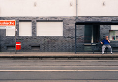 Waiting for the bus (DocTob22) Tags: cologne street streetphotography bus köln germany busstation red waiting