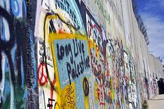 Israeli-built West Bank Wall surrounding Bethlehem with mural art, Bethlehem, West Bank, Israel (anthonyasael) Tags: anthonyasael asael westbank bethlechem betlehem bethlehem palestine israel middleeast asia mural art muralart colorful painting graffiti fresco drawing street streetart banksy artist politicsandgovernment buildstructure exterior buildingexterior wall separationwall concrete separation horizontal nopeople israelpalestine