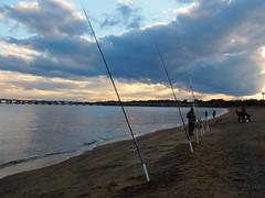 Chesapeake Fishermen (pilechko) Tags: annapolis beach sandypoint fisherman fishingrods clouds sky sunset chesapeake bay