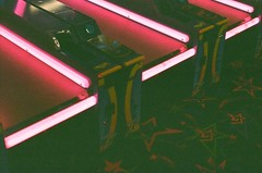 Columbia Mall Arcade in Columbia, Missouri (plasticpeaches) Tags: 35mm film filmisnotdead filmisalive filmphotography columbia missouri como mall arcade neon retro games light lighting color colorful game vintage cool pink grain