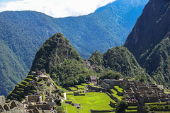 The lost city of the Incas / Затерянный город инков (Vladimir Zhdanov) Tags: travel peru andes machupicchu huaynapicchu mountains mountainside mountain landscape nature sky ruins architecture building people cloud grass tree forest