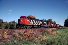 NS: CN GP40-2 9430, NS GP40X 7000, CN SD40 5960, CN SD60I 5600 west bound on ALCN near Alburtis PA Oct 14, 1999 (swissuki) Tags: ns cn gp402 gp40x sd60i sd40 railroads reading alburtis pa us