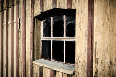 Proper ventilation (iamunclefester) Tags: westerheim broken window grille grating lattice latticewindow lines yellow red stripes proper ventilation wood facade structure texture rusty shed shelter barn door