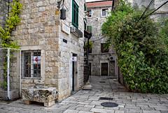 A Corner in Split (Jocelyn777) Tags: streets corners cobblestones stones stonehouses architecture buildings ruins oldtowns historictowns plants foliage doorsandwindows split croatia balkans travel