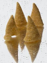 Bugles snack chip on a mirror in the rain (A  Train) Tags: nikond750 nikon tamron70200mmg2 tamron macromonday macro bfood bugle buglesnackchip generalmills mirror food snackchip salty cornchip cone raindrop reflection