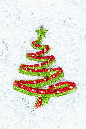 New year toy Christmas tree on snow background