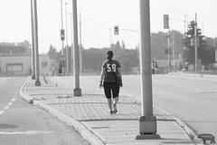 waiting_2018bw (Star Otsisto Horn) Tags: sport runner parent blackandwhite city road pavement lamppost