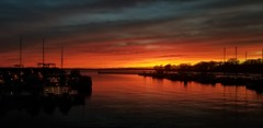 Safe Harbor Marina (sabresfreak) Tags: sunset lakeerie greatlakes calm evening clouds water boats buffalony