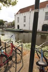 Delft, Holland; old warehouse and pakschuit (ferry) (Nescio) Tags: delft towboat pakschuit trekschuit arsenaal pakhuis gracht fiets