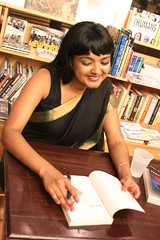 Tanwi signing books (olive witch) Tags: 2015 aug15 august book booklaunch bookstore fem indoors night nyc