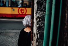 Hide and Seek (ewitsoe) Tags: 35mm city cityscape nikond80 street warszawa erikwitsoe pedestrians summer urban warsaw colors woman bokeh tram purplehair odd interesting ochota district afternoon boom