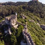 Aerial view of medieval tower of Castelo Dos Mouros with vegetation thumbnail