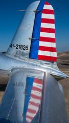 Patriotic  Plane (sniggie) Tags: bowmanfield bowmanfieldaviationmilitaryheritagefestival louisvillephotographymeetup usflag airplane changepitch changeyaw elevator rudder