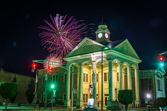 Abe Lincoln watches Independence Day in Springfield (sniggie) Tags: abrahamlincoln fourthofjulycelebration independenceday kentucky mainstreet springfield washingtoncounty washingtoncountyjudicialcenter celebration courthouse fireworks abrahamlincolnstatue sky
