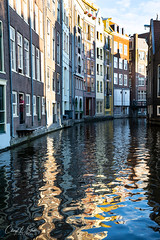Reflections & Shadows (cheryl strahl) Tags: europe netherlands thenetherlands amsterdam canal reflections shadow color water waterway man doorway evening