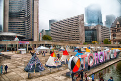 Setting up for The Indian Residential School Survivors (IRSS) Legacy Celebration (A Great Capture) Tags: nathan phillips square irsslegacy medicine wheel indian residential school survivors irss legacy celebration indigenous culture toronto council fire native cultural centre 3d sign tipi agreatcapture agc wwwagreatcapturecom adjm ash2276 ashleylduffus ald mobilejay jamesmitchell on ontario canada canadian photographer northamerica torontoexplore fall autumn automne herbst autunno 2018 cityscape urbanscape eos digital dslr lens canon 70d sigma skyline towers tower buildings structure urbannature outdoor outdoors outside vibrant colorful cheerful vivid bright architecture architektur arquitectura design
