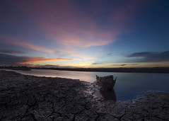 End of the life (Chamikajperera) Tags: sunset blue sky golden light outdoor landscape canon lake dry cracks