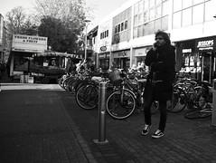 Calling You (Bury Gardener) Tags: candid cambridgeshire cambridge england uk britain streetphotography street streetcandids snaps strangers candids people peoplewatching folks 2018 nikond7200 nikon bw blackandwhite monochrome mono