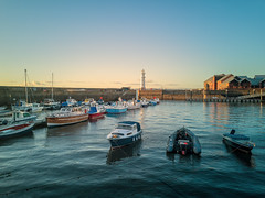 Newhaven at Sunset (MilesGrayPhotography (AnimalsBeforeHumans)) Tags: architecture britain boats city dusk edinburgh europe evening firthofforth glow golden goldenhour historic harbour haze iconic landscape leith landscapephotography lighthouse newhaven newhavenharbour newhavenlighthouse outdoors ocean photography photo reflections scotland scenic sky skyline sunset sunlight sunshine scottish scottishlandscapephotography fishing fishingboat fishingvillage huawei huaweip20pro leica mobilephone town twilight tranquil uk unitedkingdom village waterscape wide water sea seascape cameraphone