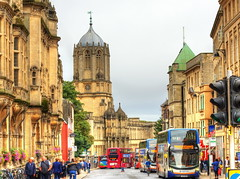 A busy St Aldates, Oxford (Digidoc2) Tags: city citystreet pedestrians oldtown buildings citylife internationallandmark downtown tomtower christchurch university college oxford staldates streetscape urban buses traffic people busy sky clouds overcast humid