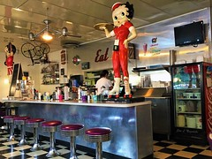 EAT! (Jan Nagalski (off for awhile)) Tags: restaurant retro midcenturymodern kitschy bettyboop purple reflection diner restaurantcounter blackandwhite floortiles 1950s chromelegtables americana cocacola cooler baycity michigan stockpot jannagalski jannagal rollerskates modelcars