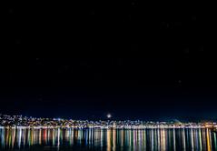 Argostoli by night 10.5mm Fisheye - Can you see the STARS ? (IanEdwards_uk) Tags: pastel colours night moon long exposure city lights setting argostoli kefalonia greek greece light reflections trails sky water boat fisheye
