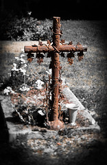 Seen in a French Churchyard (judy dean) Tags: 2018 france summer judydean holiday lensbaby hautsavoie church grave cross selectivecolour