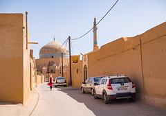 Streets of Yazd, Iran (TeunJanssen) Tags: iran yazd isfahan esfahan desert olympus omd omdem10 backpacking mft m43 travel traveling worldtravel worldtrip mosque middleeast minaret city alley street pastel woman