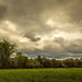 Stormy Skies Over the Hayfield.jpg