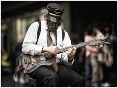 Rock and Roll Ain't Noise Pollution (gro57074@bigpond.net.au) Tags: f14 105mmf14 artseries sigma d850 nikon guitar gasmask mask musician busker cbd burkestreetmall melbourne streetperformer portrait color colour