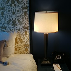 #gold #wallpaper #headboard #bed #nightstand #rotaryphone #hotel #atticushotel #mcminnville #oregon #owl #butterfly #botanical (Heath & the B.L.T. boys) Tags: instagram hotel wallpaper gold owl butterfly bed nightstand tablelamp phone telephone botanical oregon