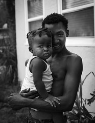 Father and Son (Beth Reynolds) Tags: father son baby portrait neighbors boys documentary street monochrome blackandwhite relationship family