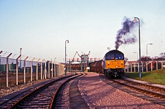 Railfreight Petroleum 47369 accelerates away from North Walsham with the regular train of North Sea Oil condensate to Harwich Parkeston Quay during November1991. (mikul44171) Tags: 47369 northseaoilcondensate november1991