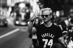 Favelas (Sean Batten) Tags: london england unitedkingdom gb streetphotography street blackandwhite bw candid person selfie man nikon d800 70200 city urban eastlondon iphone smartphone