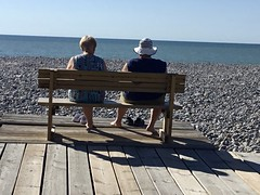 What brings the future? (Antropoturista) Tags: france somme cayeux beach flintstone women bench view future ocean deck