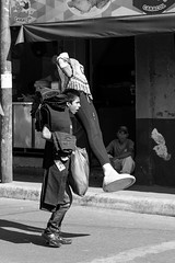 The boy and the dummy (Nino La Corte) Tags: street photography boy dummy jeans market