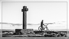 At the cross where I first saw the light (Paul Thackray) Tags: yorkshire northyorkshiremoorsnationalpark spauntonmoor rosedale annacross ainhowecross cyclist blackandwhite 2018