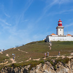 Red Lighthouse with Tourists at the Cabo da Roca coast in Portugal thumbnail