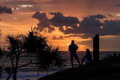 Sunrise Conversation (armct) Tags: sunrise burleighheads burleighnationalpark silhouette clouds rays crepuscular surf surfbeach pandanus hillside walkway walkers conversation waves reflection goldcoast horizon skyline reedited