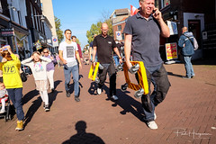 Candid with yellow (PaulHoo) Tags: fujifilm x70 gouda city candid people citylife 2018 sun orange yellow color blinded contrast streetphotography