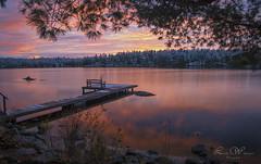 Finally, A Great Sunset.. (Lindaw9) Tags: lake dock sunset sundown the blue hour pine trees treeline bench fishing net shoreline rocks sky northern ontario