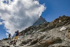 Hiking up to the refuge of Matterhorn&  Hörnli  (Hörnlihütte ) Zermatt. Canton of Valais . Switzerland. izakigur 01.09.09, 15:12:36No, 1777. (Izakigur) Tags: switzerland svizzera lasuisse lepetitprince thelittleprince ilpiccoloprincipe helvetia liberty izakigur flickr feel europe europa dieschweiz ch musictomyeyes nikkor nikon suiza suisse suisia schweiz suizo swiss سويسرا laventuresuisse myswitzerland landscape alps alpes alpen schwyz suïssa luz lumière light licht ضوء אור प्रकाश ライト lux światło свет ışık zermatt matterhorn cervin cervino valais wallis