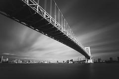Rainbow Bridge (Bunaro) Tags: rainbow bridge tokyo shibaura odaiba japan nippon nihon asia monochrome longexposure calm water streched clouds waterscape landscape cityscape sea ocean blackandwhite canon m50