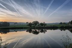 Vol au dessus du lac (Thierry Delhez) Tags: lac ciel trainée coucherdesoleil eau arbre nature paysage chemtrail lake water sky sunset tree landscape